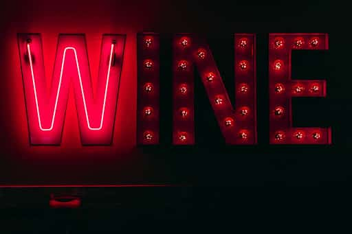 "neon red ""wine"" sign"